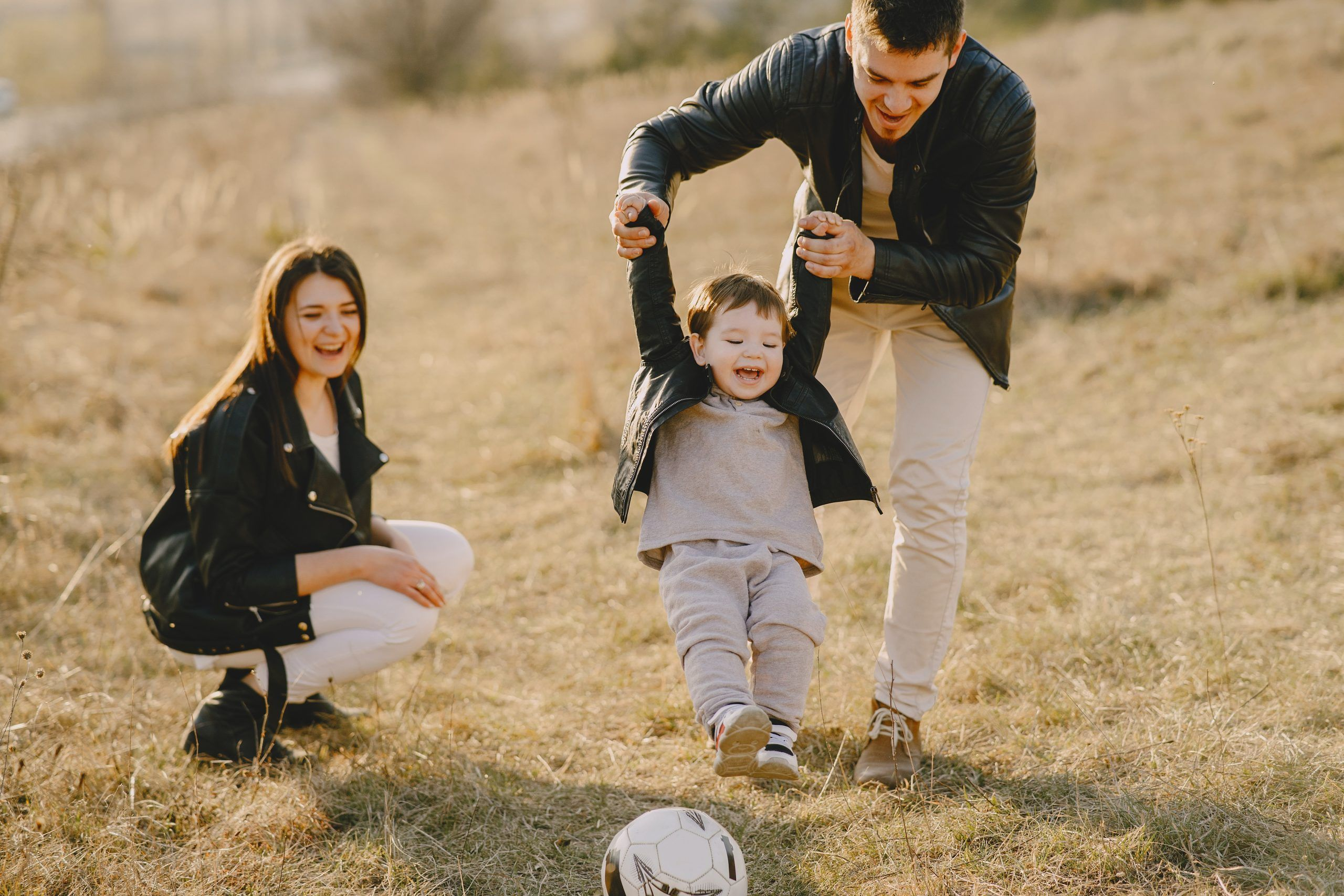 Parents and toddler playing